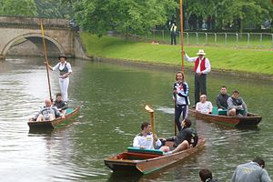 2012 Summer Olympics torch relay - The Olympic torch being punted down the River Cam during the Cambridge leg of the 2012 Summer Olympics torch relay.