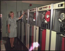 PFC Patricia Barbeau operates a tape-drive on the IBM 729 at Camp Smith.