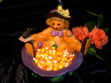 A bowl filled with candy corn