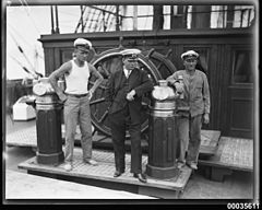 Captain Lorenz Peters with crew members near the ship's wheel on MAGDALENE VINNEN (9074353224).jpg