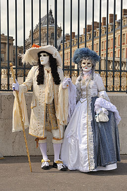 Carnival versions of Louis XIV and Marie-Antoinette in front of Versailles Palace