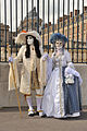 Carnival versions of Louis XIV and Marie-Antoinette in front of Versailles Palace.jpg