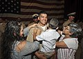 Chief Gunners Mate John Zuniga is frocked by family members. (37073444212).jpg