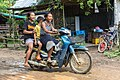 Children laughing on a motorcycle in Laos.jpg