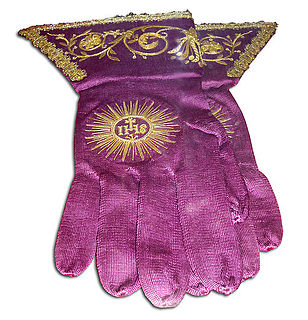 Episcopal gloves glove worn by a Roman Catholic bishop when celebrating Solemn Pontifical Mass