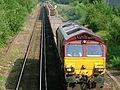 Class 66 66028 hauls long-welded-rails at Chertsey 2005-06-20.JPG