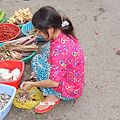 Cleaning fish by market woman Vietnam.jpg