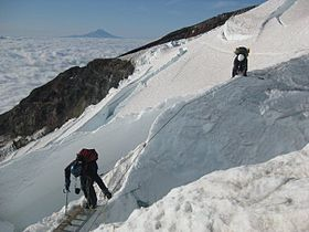 Climbers Crossing Crevasse Mt. rainier.jpg