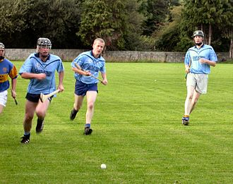 Hurling - A club hurling match in play, before the helmet regulation