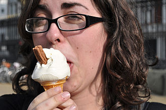 Cornish ice cream - A woman eating a Cornish ice cream cone