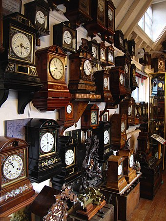 Antique cuckoo clocks in the interior of Cuckooland Museum, Tabley, England Cuckooland Museum clocks by Kirsty Davies.jpg