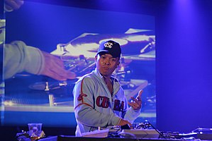 Turntablism - DJ Q-bert manipulating a record turntable at a turntablism competition in France in 2006.