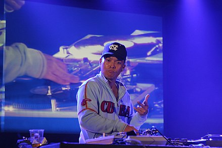 DJ Q-bert manipulating a record turntable at a turntablism competition in France in 2006. DJ Q-bert in France.jpg