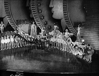 "The Gold Diggers' Song (We're in the Money) - ""Dance of the Dollars"" production number launches the song in Gold Diggers of 1933"