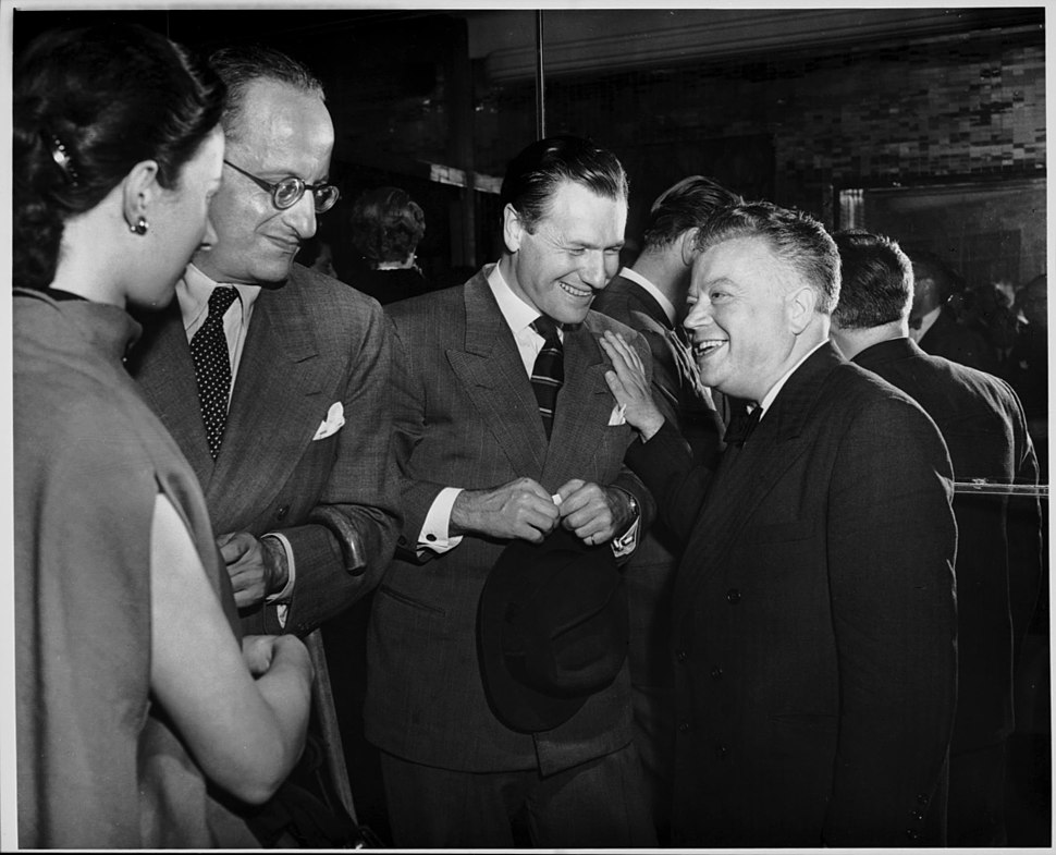 David Dubinsky and Nelson Rockefeller socialize with others.