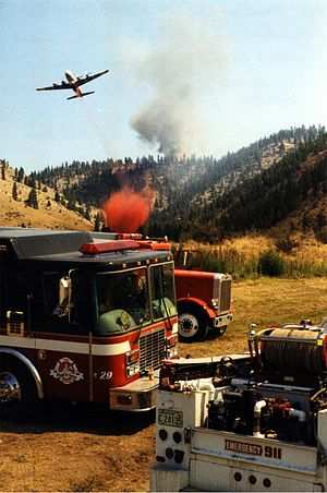 Wildfire suppression - In this picture, retardant drops, bulldozer fire-lines and firing operations are used in an indirect attack on a large fire near Chelan, WA