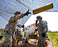 Defense.gov News Photo 110615-A-3108M-016 - U.S. Army Sgt. Adam Phillips tosses an empty canister from an M119A2 105mm howitzer during platoon evaluations at Fort Bragg N.C. on June 15.jpg