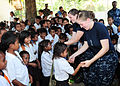 Defense.gov News Photo 110620-F-HS649-673 - Ensign Allison Luzwick left and Yeoman 2nd Class Victoria Kent dance with Timorese students at Manleuana Primary School during a community service.jpg