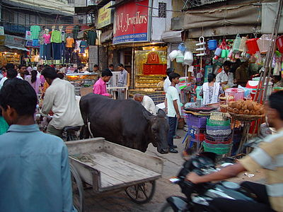 Microeconomics analyzes the market mechanisms that enable buyers and sellers to establish relative prices among goods and services. Shown is a marketplace in Delhi.