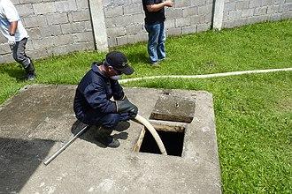 Fecal sludge management - Desludging using proper personal protective equipment in Dumaguete, Philippines