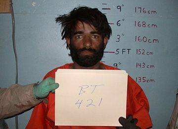 Mugshot of taxi driver Dilawar at the Bagram prison where he died. Dillawar.jpg