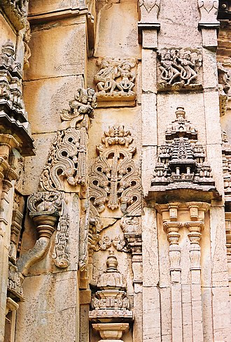 Doddabasappa Temple - Wall relief in projections and recesses: Kirtimukha, Pilasters and dravida style miniature towers (aedicule)