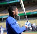 Dodgers outfielder Yasiel Puig warms up during batting practice before NLCS Game 4. (29805630714).jpg
