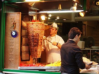 Doner kebab - Doner meat being sliced from a rotating spit in Istanbul (2012).