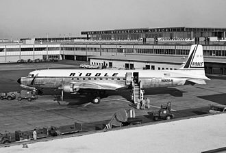 Airlift International - Riddle Airlines Douglas DC-7 at JFK International Airport (July 1962)