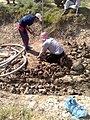 Drilling a hand dug well inside the river 01.jpg