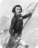 Black and white print of a young man carrying a flag in his left hand and a saber in his right hand. He wears a dark military uniform coat with white breeches.