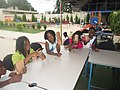 Fabrication des sacs bio en équipe à Eco Camp BENIN.jpg
