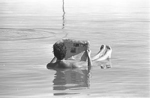 Flickr - Government Press Office (GPO) - A man reading a newspaper while bathing in the Dead Sea..jpg