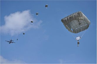 United States Army Airborne School - Students jump from a C-130 using T-11 parachutes during the Airborne School's final week of training