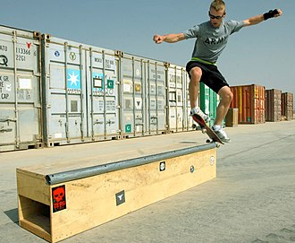 "Grind (skateboarding) - A U.S. Army soldier grinding on a purpose-built ""grind box"" in Iraq."