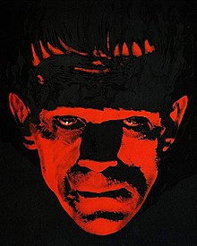Painting of the face of Frankenstein's monster, illuminated in red and surrounded by darkness