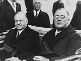 On the way to his inauguration, President-elect Franklin D. Roosevelt (right) shares a car ride with outgoing president Herbert Hoover