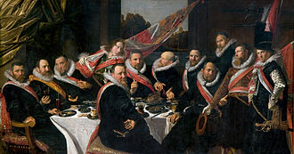 The Banquet of the Officers of the St George Militia Company in 1616 - The entire painting is on one piece of seamless linen 175 × 324 cm, and a full meter wider than its predecessor by Cornelis van Haarlem, which was painted on oak panels. An impression of space and depth is given by diagonal lines leading the viewer to gaze beyond the flag out the window.