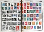 French postage stamps on album pages.jpg
