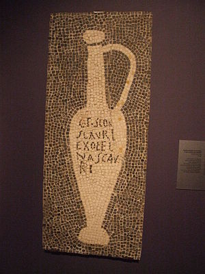 "History of marketing - Mosaic showing garum container, from the house of Umbricius Scaurus of Pompeii. The inscription which reads ""G(ari) F(los) SCO(mbri) SCAURI EX OFFI(CI)NA SCAURI"" has been translated as ""The flower of garum, made of the mackerel, a product of Scaurus, from the shop of Scaurus"""