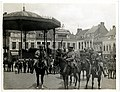 Gen. Sir J. Willcocks with personal staff & escort riding through a French town (the Grande Place in Merville). Photographer- H. D. Girdwood. (13874989734).jpg