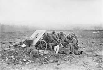 Skoda 75 mm Model 15 - German anti-tank gunners and supporting infantry, October 1918