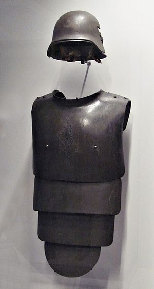 Cuirass - German helmet and frontal armoured plate for trench warfare, 1916