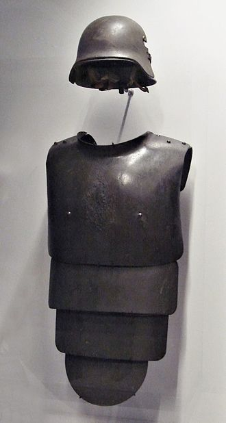 Cuirass - German helmet and frontal armored plate for trench warfare, 1916