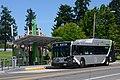 Gillig hybrid bus on C-Tran route 30 passing a Vine station (2017).jpg