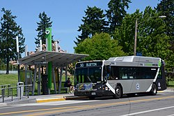 Gillig hybrid bus on C-Tran route 30 passing a Vine station (2017).jpg