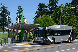 "C-Tran (Washington) - C-Tran hybrid-electric bus on route 30 in 2017, passing a station for ""The Vine"""
