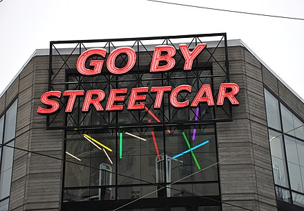 "A sign in Portland that reads ""go by streetcar."" Trams are typically called streetcars in North America. Go by Streetcar sign - Portland Oregon.jpg"