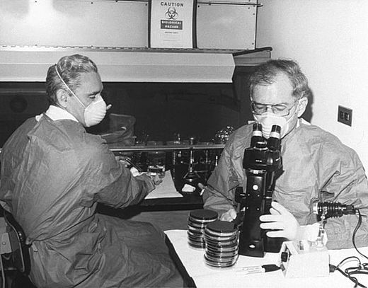 The advent of the microscope was one of the major developments in the history of pathology. Here researchers at the Centers for Disease Control in 1978 examine cultures containing Legionella pneumophila, the pathogen responsible for Legionnaire's disease. Gorman and Feeley.jpg