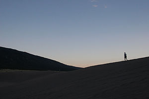 Great Sand Dunes National Park and Preserve Solitary hiker at.jpg